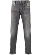 Represent frayed hem tapered jeans